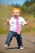 toddler boy in pint tie and red hair